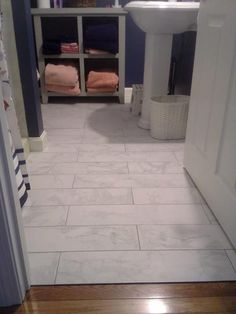 AND THE FLOOR ITS PORCELAIN LOOKS JUST LIKE MARBLEMATCHES THE - Carrara porcelain tile 3x6