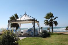 The Kefalos Beach Tourist Village is an ideal location for Weddings in Cyprus.    With the benefit of our location and facilities we have everything needed for planning Cyprus weddings in Paphos. Our wedding team are experts and make planning Weddings in Cyprus stress free. we are here to make your dreams come true, we appreciate the importance of your wedding day and our role here is to ensure that it is special and memorable. Cyprus Wedding, Our Wedding, Kefalos Beach, Paphos, Beach Weddings, Stress Free, Dreaming Of You, Gazebo, Benefit