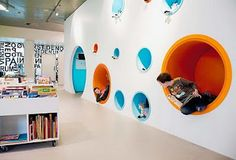 Private reading pods in the wall of the children's section at HJØRRING Central Library