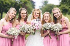 Bridesmaids in Pink dresses with baby's breath / gypsophila bouquets - Cambridge Church Wedding with Bride In Toscana By White One - Image by Albert Palmer