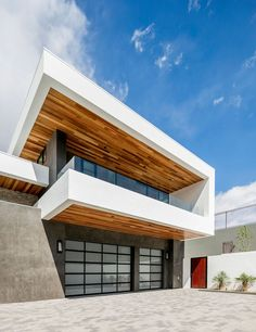 This modern house, which is located on a unique triangular lot, is totally private from the street, and has wood elements throughout.