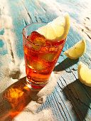 Campari with lemon slice