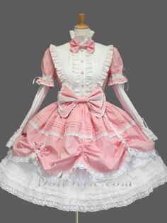 Sweet Lolita. I love the ruched overskirt and the bib and bows are amazing!
