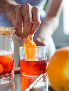 THE BOULEVARDIER  INGREDIENTS - 1 1/2 ounces bourbon - 3/4 ounce sweet vermouth - 3/4 ounce Campari - Twist of orange peel