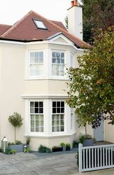 Cream house with white windows. Walls: Weathershield Jasmine White™ Smooth Masonry. Windows: Weathershield Pure Brilliant White Exterior Gloss