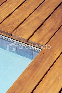 This contemporary wood deck forms the edge of a residential swimming. - Custom Ipe Wood Deck Edge at Swimming Pool Royalty Free Stock Photo -