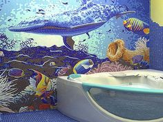 Beautiful use of color and art for this ocean mural in the bathroom. Every single tile is artfully placed.