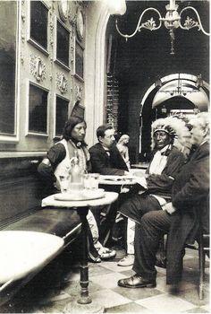 L-R: Unidentified man (Oglala), unknown, Iron Tail (Oglala), William F. Cody (aka Buffalo Bill) in Italy - circa 1888