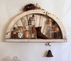 I have some old half windows from a church in Island Brook.  If I add shelf I chould do something like this.  Finally put them to use.