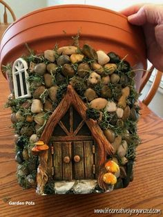 Here's how to make a sweetly whimsical DIY fairy house planter from a terra . Here's how to make a sweetly whimsical DIY fairy house planter from a terra cotta pot & other in Diy Fairy Garden, Fairy Garden Houses, Garden Crafts, Garden Projects, Fairies Garden, Garden Fun, Garden Cottage, Garden Care, Tropical Garden