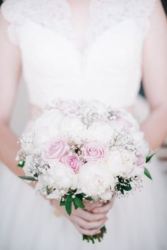 Beautiful and delicate pink and white bridal bouquet, photo by Ben Yew Photography | junebugweddings.com