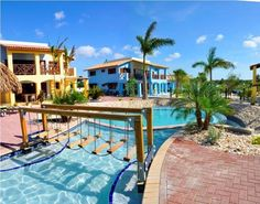 Kunuku Aqua Resort Willibrordus Kunuku Aqua Resort is a 10-minute drive from Cura?ao?s Hato Airport and 5 km from the best beaches. It offers a large outdoor pool with a slide, free Wi-Fi and free parking. Spacious apartments have a living room with a sofa bed.