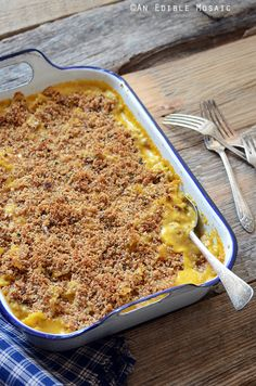 Spiced Pumpkin Mac and Cheese with Brown Butter, Sage, and Pecan Topping makes a great fall meal paired with a green salad, or is perfect as a festive Thanksgiving side dish. #recipe