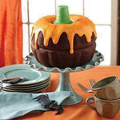 Two bundt cakes, perfect chocolate pumpkin drizzled with orange colored icing. Use a green ice cream cone for the stem!