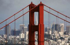 San Francisco City view. The Transamerica Pyramid building is seen through the north tower of the Golden Gate Bridge on June 20, 2007.
