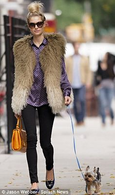 Perfect accessories: She was walking her pet terrier on a lead and carried a yellow satchel in the other hand