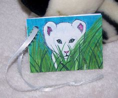 Onry White Lion Cub by Marie Logston. Marie's Imagination.