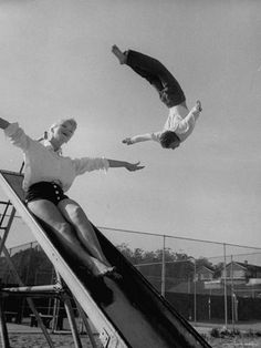 Allan Grant - Acrobat and actor, Russ Tamblyn doing a flip at a playground with movie actress Venetia Stevenson. Hollywood, S) Russ Tamblyn is AMAZING! Hollywood Scenes, Old Hollywood, Russ Tamblyn, Bodybuilding Routines, Increase Muscle Mass, Muscle Weight, Life Magazine, Playground, Actresses
