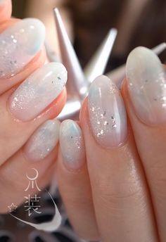 nail salon 爪装 ~sou-sou~subtle water colors, white, blue, and sparkles