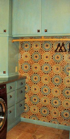 Love the wallpaper that looks like beautiful Islamic-designed tile in this laundry room. It makes the space.