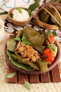 Botok Tempe (Javanese Diced Tempe coated with spiced grated coconut, wrapped in banana leaves)