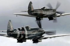 RAF late model Spitfire (in D-Day stripes) and a Supermarine Spitfire