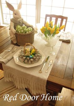 A cheerful Easter tablescap; sunny yellows meet burlap and a bunny. Too cute. (Red Door Home blog: Spring) Tablescape