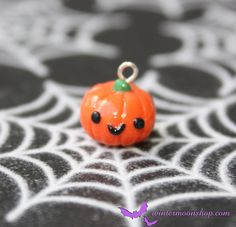 These adorable mini charms are great for charm bracelets, necklace pendants, zipper pulls, bookmarks, cell phone charms, etc. Charm measures about .5 inches. Handmade from polymer clay.    Please visit my main store at wintermoonshop.com!    © Winter Moon Shop