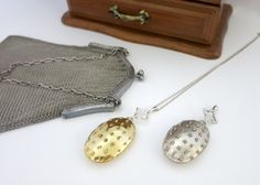 Victorian-era inspired lockets with granulation work in sterling silver and gold plated brass.
