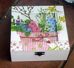 caja macetas flores