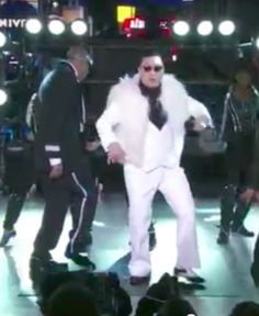 """Psy performing """"Gangnam Style""""  Hey Nic and Erin, time to add another  dance to our long list."""