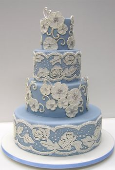 Blue and white wedding cake with beautiful lace patterns. #Tiers. @Celebrity Style Weddings