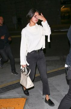 Suddently shy? Selena Gomez was all by her lonesome as she covered her face while heading to a Hillsong Church event in Los Angeles on Saturday night