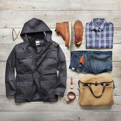 Rainy day gear. Jacket: @drizabone Blackwater 3-in-1 Cotton Nylon Shirt: @grayers Stafford Slub Twill Boots: @redwingheritage 1907 Wallet: @blackbearleather Bag: @filson1987 Denim: RRL @ralphlauren Belt: @rancourtco Watch: @tsovet #drizabone #collaboration