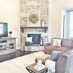 Love the stone on this corner fireplace (Smoked Leuders Chopped Stone with cream mortar) and also the furniture arrangement (open kitchen is behind the couch), mantle is cedar stained in espresso, Bassett Furniture Ellery L-shaped leather sectional in Stone, Bassett Furniture Tahoe Wool Rug in Cream. Wall color is SW Repose Gray