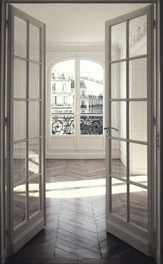Windows and doors galore. French doors with an industrial feel. The antique herringbone floors aren't bad either!