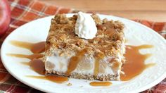 A frozen layer of apple pie ice cream laced with caramel and sandwiched between a top and bottom layer of crunchy crushed granola bars.