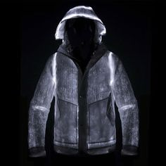 the nemen 'LED' jacket integrates optical fibers woven within the fabric, to create a lighting system that is powered by two rechargeable lithium batteries.