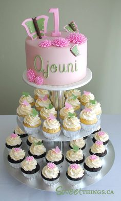 1st birthday cupcakes - Such a lovely and sweet designs! flowers are also made beautifully.