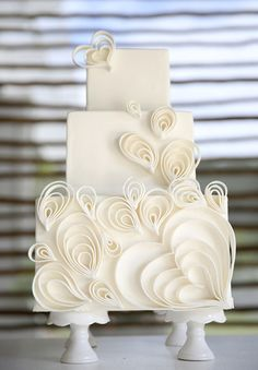 12 All-White Wedding Cakes: Add cutouts, like these heart-shaped ones, to a square stacking.