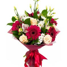 An interesting bouquet of gerberas, lizianthus and roses mixed with other seasonal flowers to give variety and flair Seasonal Flowers, Flower Delivery, Beautiful Flowers, Carnival, Floral Wreath, Wreaths, Seasons, Table Decorations, Rose