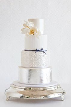 Glam wedding cakes are one of the hottest 2014 wedding trends, and I just adore them! Such cakes are better for a formal celebration, of course, but even at a more informal wedding such a cake would look great. Metallic Cake, Metallic Wedding Cakes, Silver Cake, Metallic Gold, Gold Leaf, Creative Wedding Cakes, Amazing Wedding Cakes, Wedding Cake Designs, Gorgeous Cakes