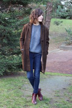 long suede coat on sweater, denim and ankle boots. casual flare.