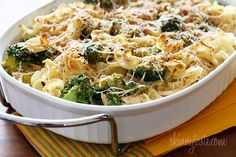 Shredded chicken breast and broccoli cooked with noodles in a light creamy sauce topped with toasted breadcrumbs. A simple dish the whole family will love, even the little ones!  Chicken and Broccoli Noodle Casserole | Skinnytaste