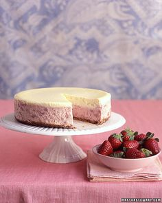 Strawberries-and-Cream Cheesecake. Intense oven-roasted strawberries are folded into a blend of tangy mascarpone and cream cheese, then covered with a rich vanilla layer -- proof that cheesecake can be both unexpected and delicious. Roasted Strawberries, Strawberries And Cream, Raspberries, Just Desserts, Delicious Desserts, Yummy Food, Dessert Healthy, Light Desserts, Healthy Food