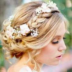 Beach wedding braided hairstyles with flower for wavy hair