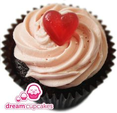 Dream Cupcakes // 'Sam Strawberry' - A delicious moist chocolate sponge with a delightful pink-coloured strawberry-flavoured frosting. Finished with a chewy heart-shaped sweet.