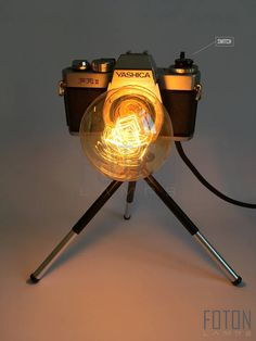 Handcrafted camera lamp made from a vintage Yashica camera. It has a 180 cm long textil cord and an integrated rotary switch. Bulb is not included (E27, max 40w, 220V). Dimensions: 28cm x 21 cm x 21cm (approximately).  Can be installed with UK or EU plug.  Please inquire about the shipping conditions!  More lamps: www.facebook.com/fotonlamps