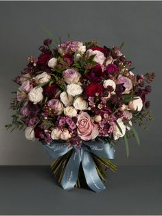 Wild At Heart - Timeless Romance Bouquet - Surprise your Valentine with this sumptuous bouquet of Black Baccara roses, lilac roses, anemones, soft pink roses, spray roses and wax flower.