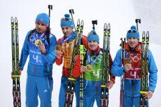 DAY 16:  Gold medalists (R-L) Alexey Volkov, Evgeny Ustyugov, Dmitry Malyshko and Anton Shipulin of Russia celebrate after the medal ceremony for the Biathlon Men's 4 x 7.5 km Relay